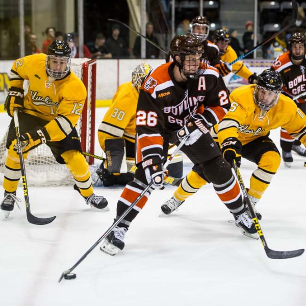 BG's Mark Cooper controls the puck against Michigan Tech during Saturday night's 3-2 victory. (Photo by Todd Pavlack/BGSUHockey.com).