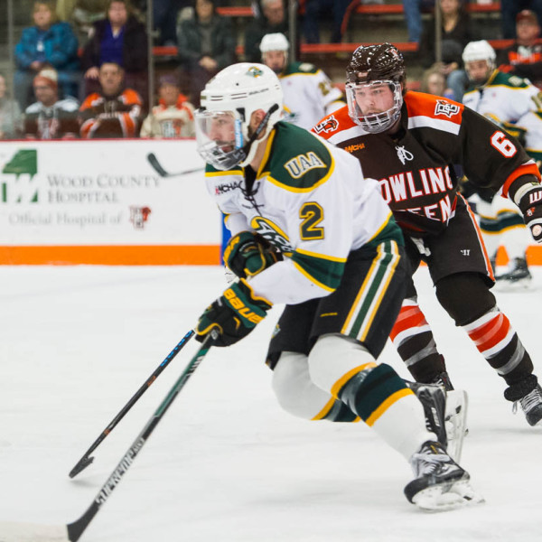 Bowling Green's Mitch McLain (6) closes in on Alaska-Anchorage's Stephen Baylis earlier this season (Photo by Todd Pavlack/BGSUHockey.com).